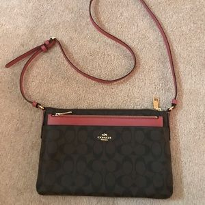 Dark brown and pink Coach cross body bag